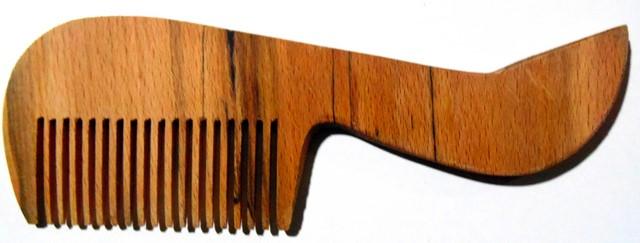 Гребінець дерев'яний в прозорій упаковці